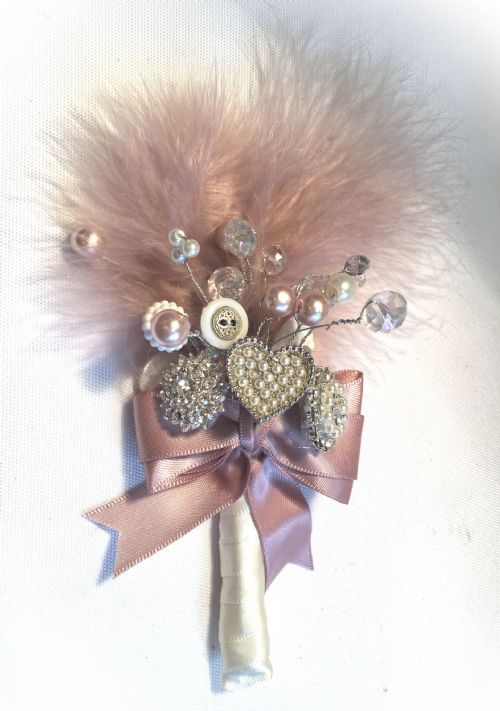 Dusky pink feather and brooch buttonhole